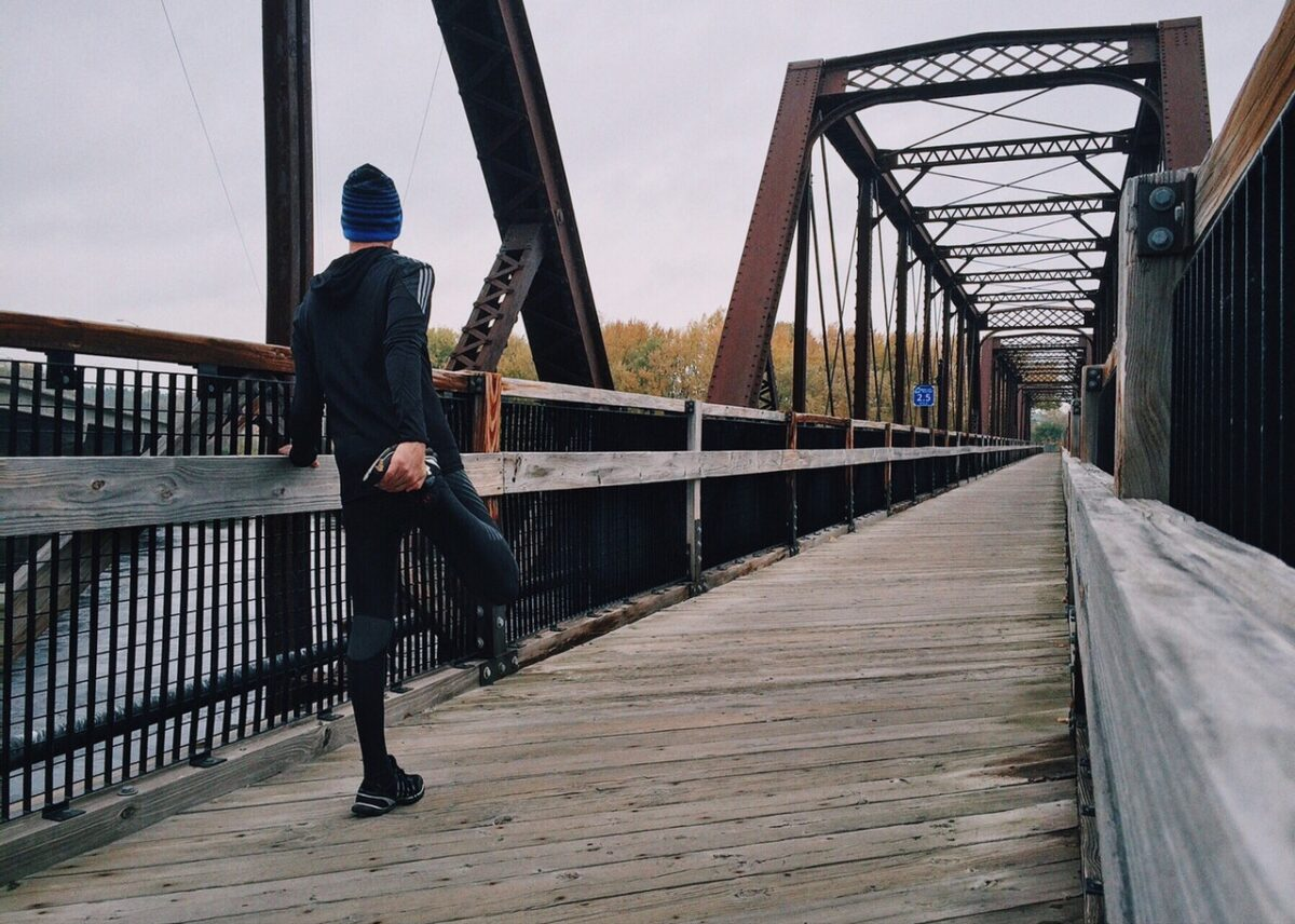 A runner on a bridge, training for a 5k.