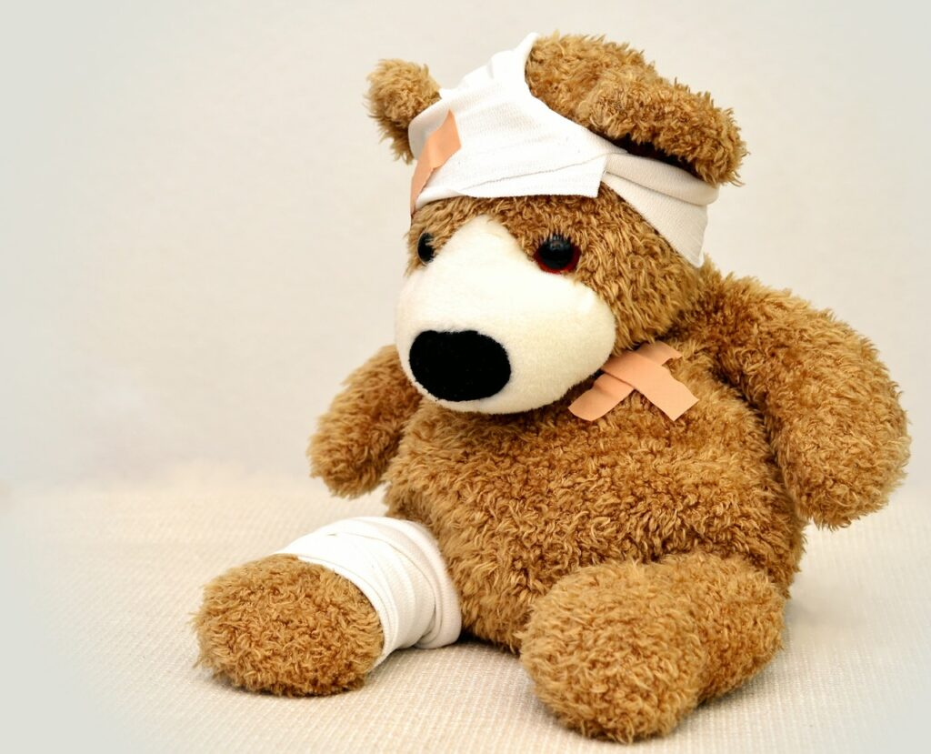 A stuffed bear with bandages all over. Don't progress to quickly, or you'll get injured when you start running.
