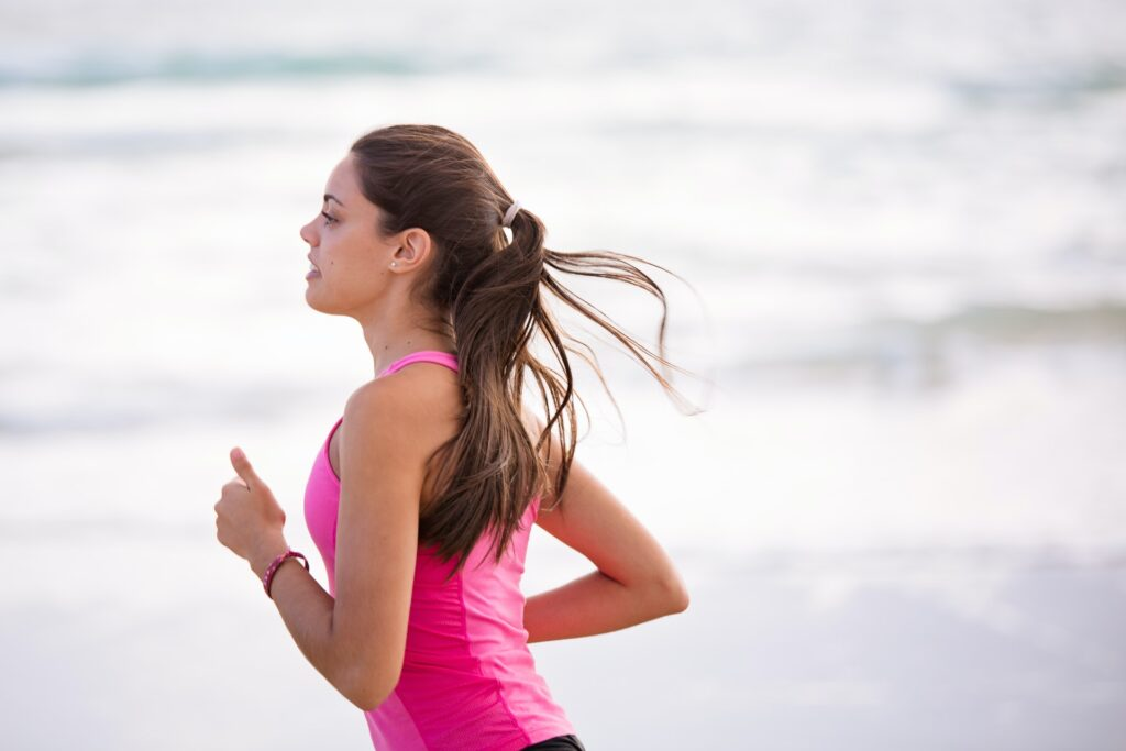 A woman using a 12 week half marathon training plan to train for her race.