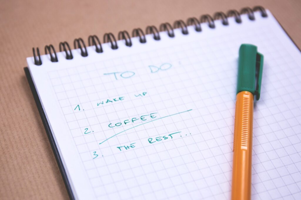 Close up of a notebook and a pencil, with a to do list. This is a great way to make running an effective habit.