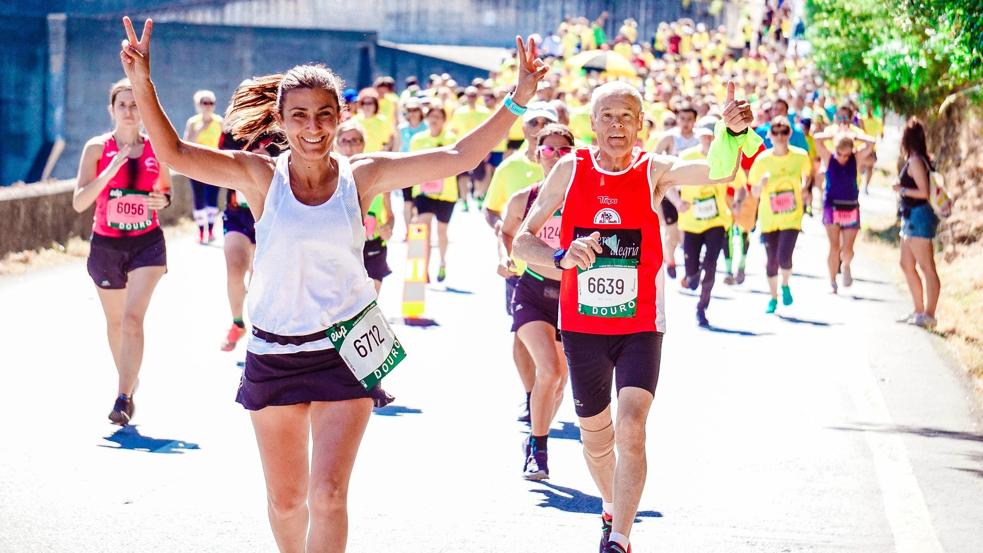 A woman finishing a race. She got back into running and met her goals.